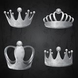 Set of old silver crowns isolated Stock Images