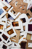 Set of old slides, photos and film on table Royalty Free Stock Image