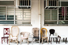 A set of old style chair in a line. This set of old style chair sit in the So-Uk Estate, one of the eldest government build estate in Hong Kong Stock Image