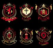 Set of old style heraldry emblems, vintage illustrations. Decorated with monarch accessories, towers, pentagonal stars, weapon and armory. Coat of Arms Royalty Free Stock Photos