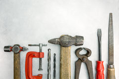 Set of old tools on metal background Royalty Free Stock Photos