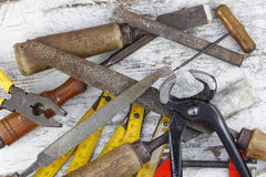 Set of old tools. In a wood background stock photo