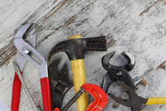 Set of old tools. In a wood background royalty free stock photo