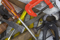 Set of old tools. In a wood background royalty free stock photos