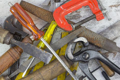 Set of old tools. In a wood background stock photography
