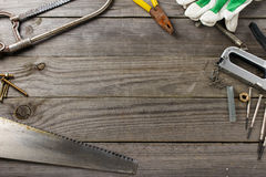 Set of old tools. On a wooden table in the workshop with space for your text, top view stock images