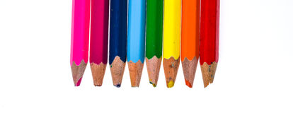 Set of old used and broken colour pencils isolated white. Royalty Free Stock Photos