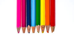 Set of old used and broken colour pencils isolated white. Stock Photo