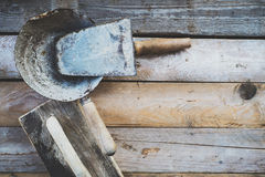 Set of old used masonry tools on a rough wooden surface Stock Images