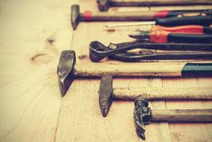 Set of old vintage hand construction tools on a wooden background, well used retro concept.  royalty free stock photo