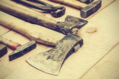 Set of old vintage hand construction tools on a wooden background, well used retro concept.  royalty free stock photos