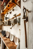 Set of old watering cans and old gadgets Stock Photography