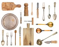 Set of old and wooden items. Silverware, kitchen accessories. Spoons, forks, plate, board, saltcellar and more isolated on white stock photos