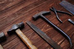 The set of old worn file and a hammer isolated on wooden grunge Stock Photos