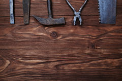 The set of old worn tools with a copy space on wooden background Royalty Free Stock Photo