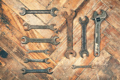 Set of old wrenches on wooden floor Stock Photography