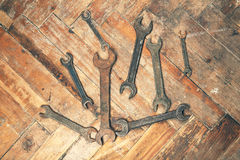Set of old wrenches on wooden floor Royalty Free Stock Image