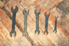 Set of old wrenches on wooden floor Royalty Free Stock Photos