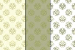 Set of  olive green floral backgrounds. Seamless patterns. Olive green floral backgrounds. Set of seamless patterns for textile and wallpapers Royalty Free Stock Photo