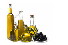 Set of olive oil bottles and black olives. Jars with olive oil and some olives isolated over a white background stock photography