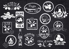 Set of olive oil labels, badges and logos for. Design over blackboard. Vector illustration royalty free illustration