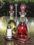 Set of olive oil and vinegar bottles on a table Royalty Free Stock Photos
