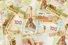 Set of one hundred Russian rubles banknotes with Crimea symbolics. Special banknote edition dedicated to incorporation of the Crimea region into Russian Royalty Free Stock Photography