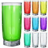 Set of opaque glasses with multicolored drinks. On white background Stock Photo