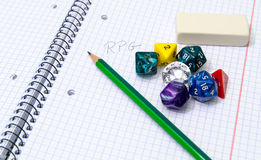 Set of open exercise book, pencil, rubber and dices  on Royalty Free Stock Photos