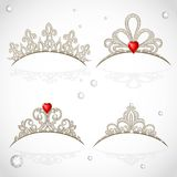 Set openwork jewelry tiaras with diamonds and faceted red stones Stock Images