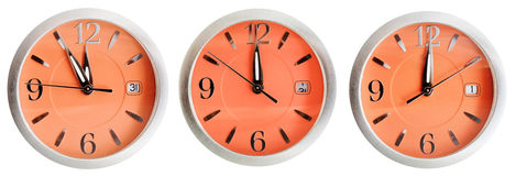 Set of orange clock faces with midnight time Stock Photos