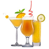 Set of orange cocktails with decoration from fruits and colorful straw isolated on white background Royalty Free Stock Photography