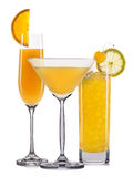 Set of orange cocktails with decoration from fruits and colorful straw isolated on white background Stock Photos