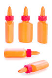 Set of orange glue bottles from all angles Stock Photos