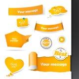 Set of orange labels and paper badges. Stock Image