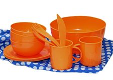 Set of orange plastic utensils for picnic Royalty Free Stock Photography
