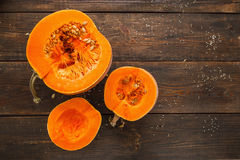 Set of orange pumpkins on wood flat lay free space. Fresh cut squashes on wooden table, country autumn background. Seasonal, harvest, fall, organic food Royalty Free Stock Photos
