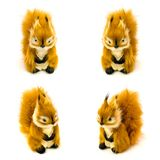 Orange statuettes of a squirrels isolated on a white background Stock Photo