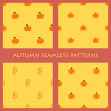 Set of orange vector seamless autumn patterns with pumpkins, apples, maple leaves stock illustration