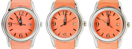 Set of orange wristwatches with midnight time Royalty Free Stock Image