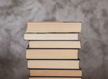 Set of books ordered. Set of ordered books in which you can see the used sheets that symbolize their regular reading. Image on an abstract background Stock Images