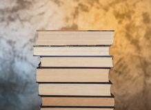 Set of books ordered. Set of ordered books in which you can see the used sheets that symbolize their regular reading. Image on an abstract background Stock Photo