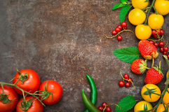 Set organic food. Fresh raw vegetables for salad. On a old black background. Top view. Close-up Royalty Free Stock Image
