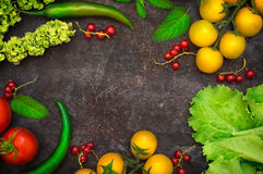 Set organic food. Fresh raw vegetables for salad. On a old black background. Top view. Close-up. Set organic food. Fresh raw vegetables for salad. On a old black Stock Photo