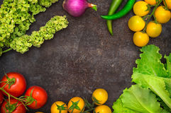 Set organic food. Fresh raw vegetables for salad. On a old black background. Top view. Close-up. Set organic food. Fresh raw vegetables for salad. On a old black Stock Photos