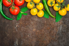 Set organic food. Fresh raw vegetables for salad. On a old black background. Top view. Close-up Royalty Free Stock Photo