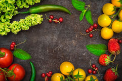 Set organic food. Fresh raw vegetables for salad. On a old black background. Top view. Close-up. Set organic food. Fresh raw vegetables for salad. On a old black Royalty Free Stock Photography