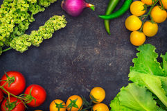 Set organic food. Fresh raw vegetables for salad. On a old blue background. Top view. Close-up. Set organic food. Fresh raw vegetables for salad. On a old blue Stock Image