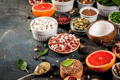 Set of organic healthy diet food, superfoods. Beans, legumes, nuts, seeds, greens, fruit and vegetables. Dark blue background copy space royalty free stock image