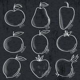 Set of organic vegetable and fruit on blackboard Royalty Free Stock Photos